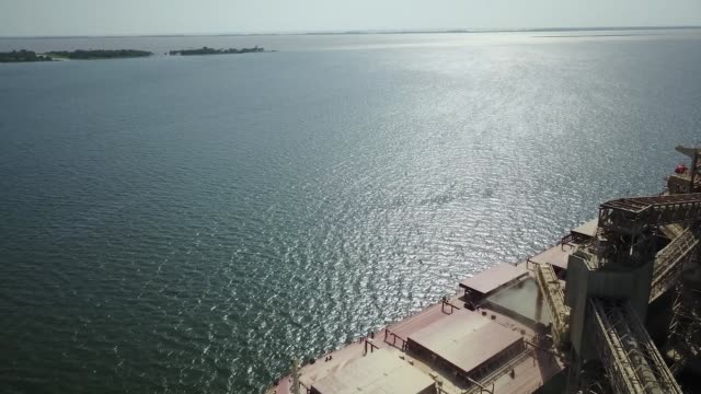 Drone footage of a bulk carrier at the Cargill grain port by the Tapajos river in Santarem Amazonian state of Para Brazil on August 22 2017...