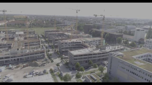 Drone footage of construction cranes working on residential apartment blocks with environmentallyfriendly roofing in Berlin Germany on Friday July 28...