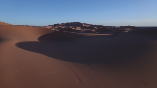 Drone footage of sand dunes during sunset, Erg Chebbi, Morocco