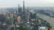 Drone footage of Shanghai showcases iconic Shanghai skyline as seen from the Huangpu river and the Bund opposite Buildings include Oriental Pearl...