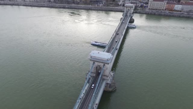 Drone footage of the Budapest skyline over Margaret Bridge panning towards the Hungarian Parliament Building on the Danube in Budapest Hungary on...
