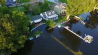 WGN Drone POV Sandbags Protect Lake Houses From Floodwaters in Algonquin Illinois on July 16 2017