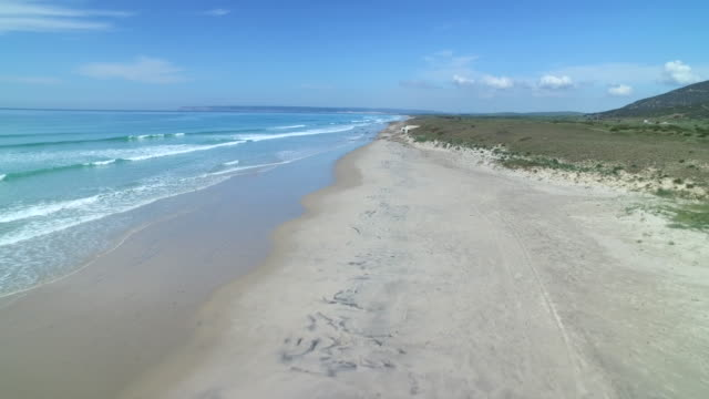 Drone shot flying over a sandy beach in Cadiz province, Spain.