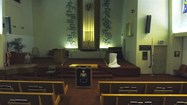 Drone tracking shot through synagogue chapel with Torah and Torah ark