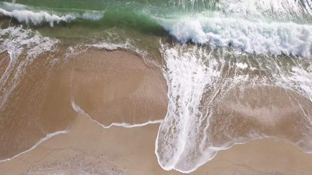 4K Drone view of sea waves and beach