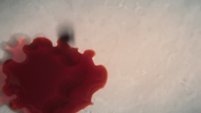 Drops of Blood Landing on White Surface, Slow Motion
