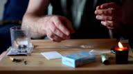 Drug Addict Cutting Cocaine Lines