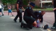 Record numbers dying from drug use in England and Wales T24071713 / TX WALES Wrexham Police officers struggling to restrain man on ground