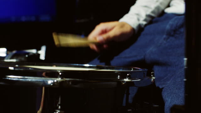 Drummer playing on drum set. close up