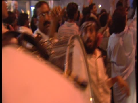 Drummers marching through streets as part of rally