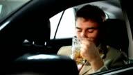 Drunk businessman in the car