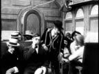 1910 B&W Drunk man staring fight in train/ USA