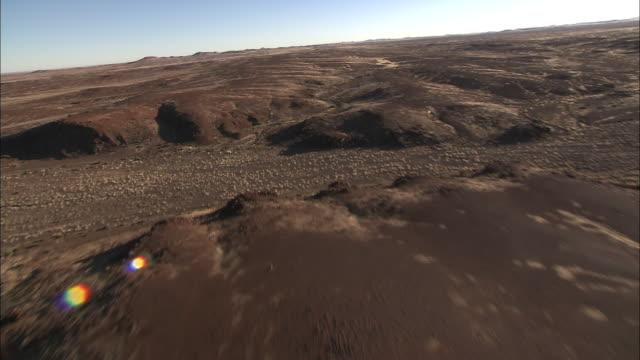Dry riverbeds cut through the Kalahari Desert in Botswana. Available in HD.