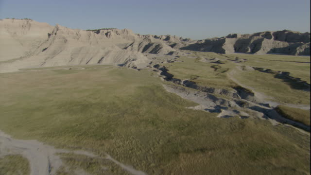 Dry riverbeds snake across the Badlands of South Dakota. Available in HD.