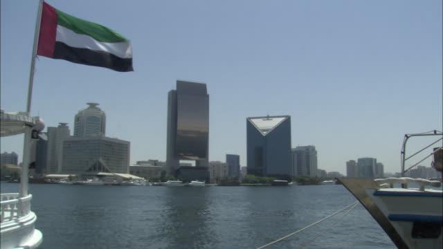 WS, Dubai Creek and National Bank of Dubai in background, Dubai, United Arab Emirates