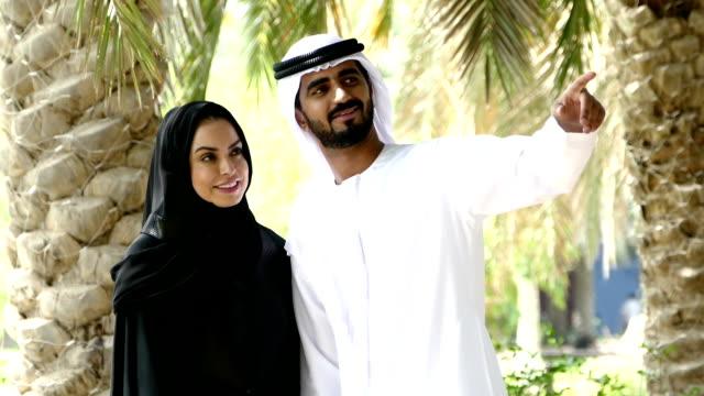 Dubai - Traditional Emirati young couple outside