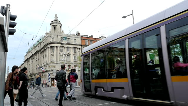 Dublin city center with luas crossing and pedestrians