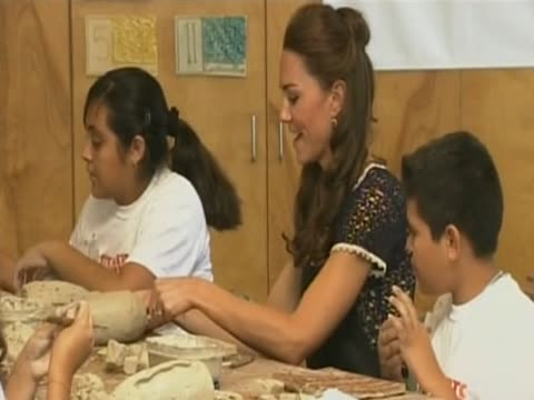 Duchess of Cambridge does some modelling with children at one of her chosen charities