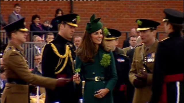 Duchess of Cambridge presents shamrocks to the Irish Guards Duchess presenting shamrocks to Irish Guards / Irish Guards soldiers with shamrocks...