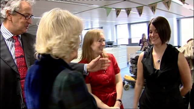 Duchess of Cornwall visits BBC Studios in Birmingham Camilla touring Countryfile section of office and meeting staff members / Camilla shaking hands...