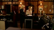 Duchess of Cornwall visits Coronation Street INT Camilla Duchess of Cornwall onto set of Rovers Return pub and watching scene being filmed / Camilla...