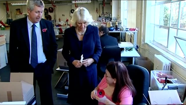 Duchess of Cornwall visits poppy factory Poppies being assembled / Duchess of Cornwall being shown the Remembrance Day crosses that The Poppy Factory...