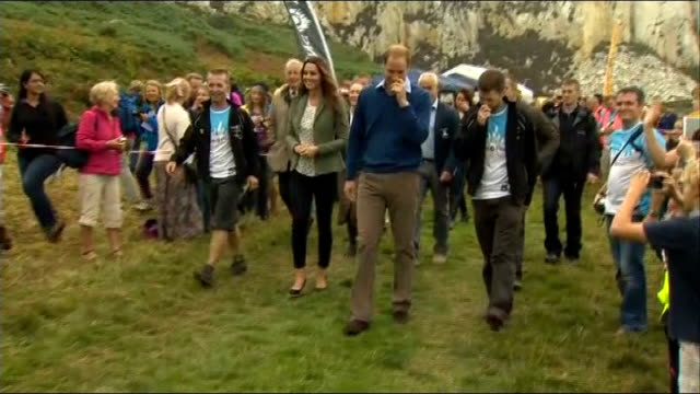 Duke and Duchess of Cambridge at Ring of Fire ultra marathon **Music heard intermittently SOT** William and Kate towards and chatting to others /...