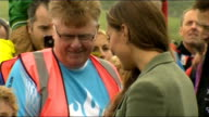 Duke and Duchess of Cambridge at Ring of Fire ultra marathon **Music heard intermittently SOT** People waiting / Kate and Willliam walking towards /...