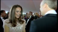 Duke and Duchess of Cambridge attend ARK charity dinner More shots of William and Catherine chatting to guests