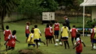 Duke and Duchess of Cambridge Far East and South Pacific tour Day 7 Solomon Islands William putting on baseball cap / William kicking football about...
