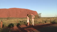 Duke and Duchess of Cambridge posing for photos in front of Uluru during royal visit
