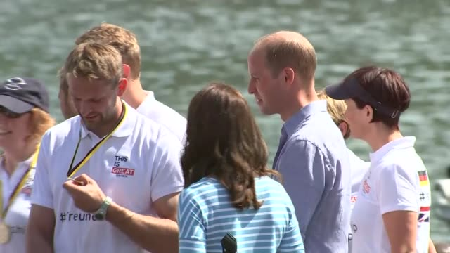 Duke and Duchess of Cambridge take part in boat race finish William and Kate listening to speech and awarded medals / both mingling with rowers /...