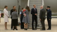 Duke and Duchess of Cambridge visit ends with Anzac Day ceremony Duchess of Cambridge stands on runway holding Prince George as talking to Australian...