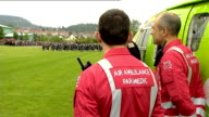 Duke and Duchess of Cambridge visit Scotland Crieff William along shaking hands and chatting / Air Ambulance crew / Paramedics waiting / Close Shot...