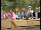 Duke and Duchess of York in Canada special report Kaminstiquia Fort William River Canoe with several people in it paddled towards TBV Canoe away MS...