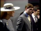 Duke Duchess of York in LA CMS 'NUMBER 5' ROBOT SOF 'I am CMS Sarah in grey suit with white widebrimmed hat PULL OUT Andrew next to her as Number 5...