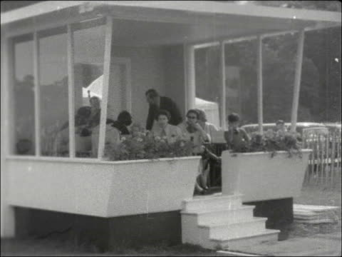 EXT Prince Philip on horse with polo gear Philip meeting people Philip mounting horse Royal family watching from box polo match in progress Royal...