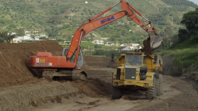 WS Dump truck being loaded on construction site / Malaga, Andalusia, Spain
