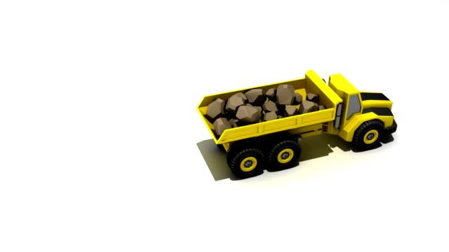 Dump truck dumping rocks