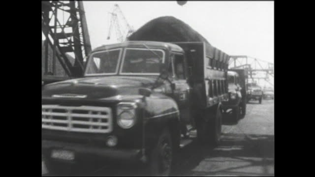 A dump truck loaded with coal departs from the Port of Nagoya.