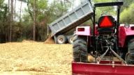 Dump truck unloads dirt for construction site.