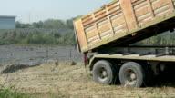 Dumper truck unloading soil at construction site