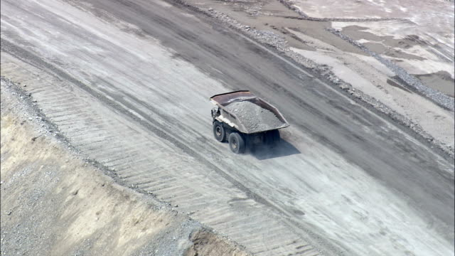 Dumper Trucks Working In Copper Mine  - Aerial View - Montana,  Silver Bow County,  helicopter filming,  aerial video,  cineflex,  establishing shot,  United States