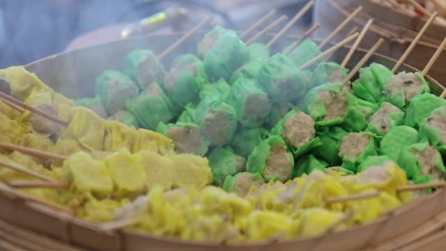 Dumplings are steamed in a pot.