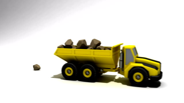 Dumptruck filled and dumping a bunch of rocks