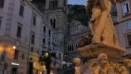 Duomo di Amalfi and statue on Duomo Piazza at dusk, Amalfi, Costiera Amalfitana (Amalfi Coast), UNESCO World Heritage Site, Campania, Italy, Europe