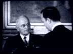 During a visit to New York City Hall President Truman presents Mayor Wagner with a Distinguished Service Award and answers reporter questions...