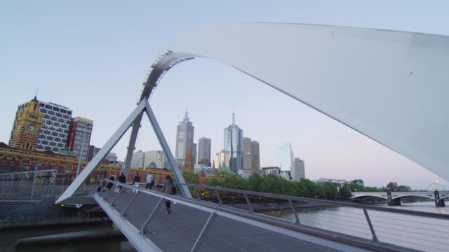 T/L dusk over Yarra Footbridge with Skyline of CBD, Melbourne, Victoria, Australia.