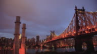 T/L WS Dusk to night cityscape with Queensboro Bridge in foreground, New York City, New York State, USA