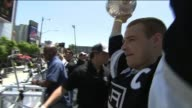 Dustin Brown Holds up Stanley Cup in Kings Victory Parade
